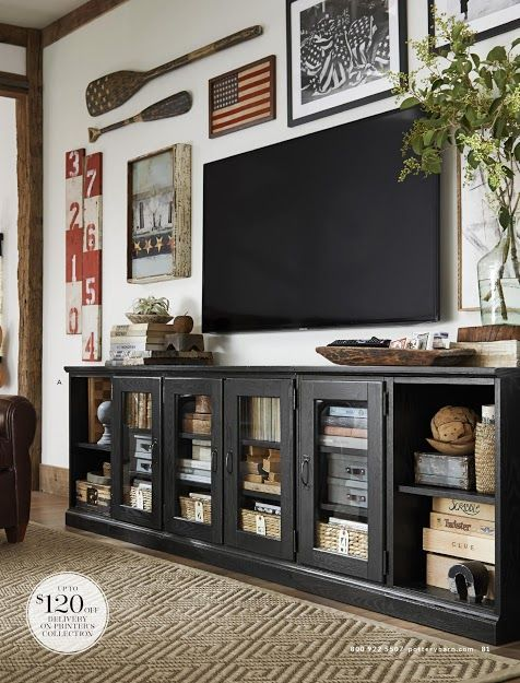 Like the idea of blending the TV screen in with artwork and artifacts
