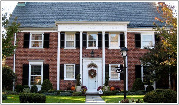 black shutters brick house - Google Search