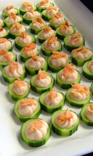 cucumbers topped with.... hummus?