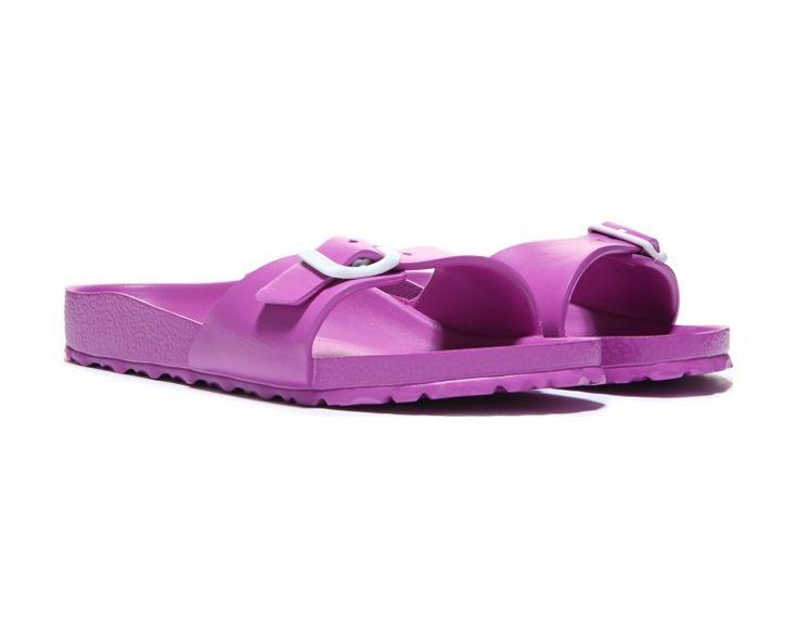 Enhance your warm weather ensemble with the Essentials Madrid sandal from Birkenstock.Waterproof EVA upper in slide sandal style with an open toeRoomy toe boxAdjustable instep strap with a buckle closureDeep heel cupVegan-friendly footwearMolded EVA footbedEVA outsole