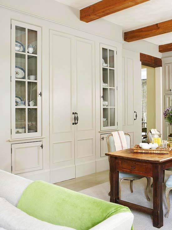 Chic Built-In Doors  Interior doors create an illusion of space beyond, even when they just open up to a china cabinet. Doors like these are the perfect way to conceal storage and to trick guests into thinking a space is larger.The Doors, Interiors Doors, Decor Ideas, China Cabinets, House Ideas, Doors Design, Doors Interiors, Pocket Doors, Cabinets Doors