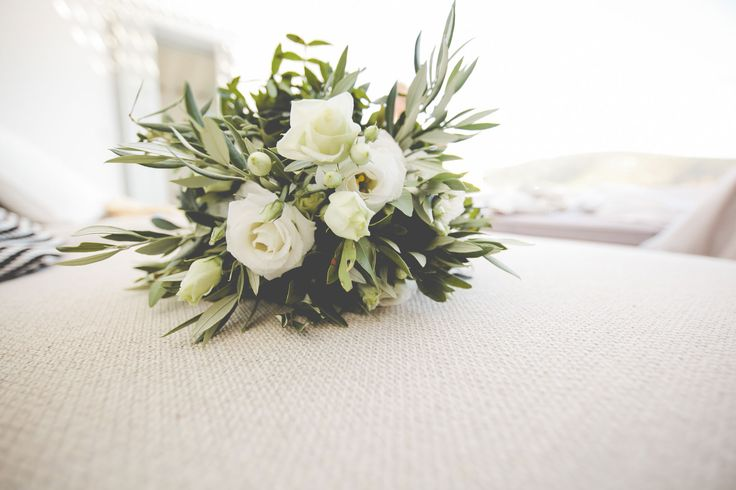 Stunning bridal bouquet made of white garden roses, lysianthus and olive brunches!