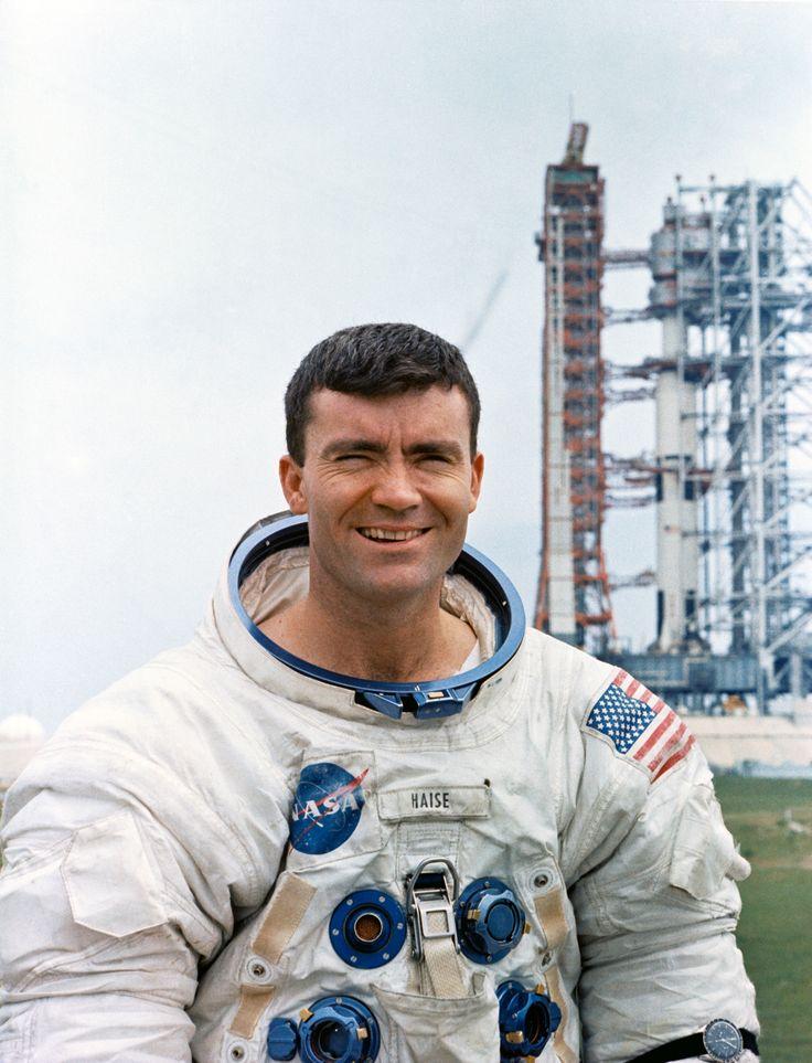 Astronaut Fred W. Haise Jr. lunar module pilot of the Apollo 13 lunar landing mission with Saturn V rocket behind. April 6 1970