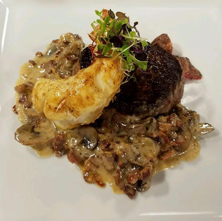 Pan Seared Filet Mignon, Sous Vide cooked Lobster Tail finished with a Wild Mushroom and Bacon Cream Sauce