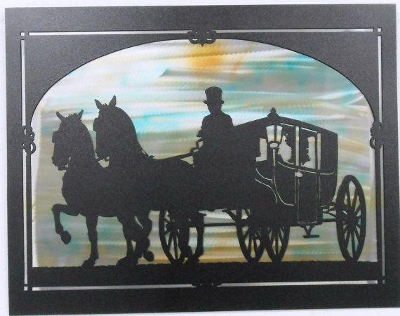 Horse and Carriage We cut our Horse and Carriage Wall Art from cold rolled steel using our CNC plasma table. After cutting this piece it was cleaned up and polished. The front layer was then covered in a black powder coat. The Back layer had special metal solvent dyes applied to it using an air brush technique. The back layer was then covered with a clear powder coat. We do our own powder coating to keep the costs down and the quality up. Powder coat is a durable and long lasting finish…