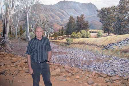 This is Jeff Morgan who painted a 360degree panorama of the Flinders Rangers because his town was dying and he through it would drawn visitors. Last year 100,000 people visited his panorama