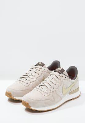 Baskets basses Nike Sportswear INTERNATIONALIST PREMIUM - Baskets basses - string/metallic gold grain/dark storm beige: 95,00 € chez Zalando (au 23/05/16). Livraison et retours gratuits et service client gratuit au 0800 740 357.
