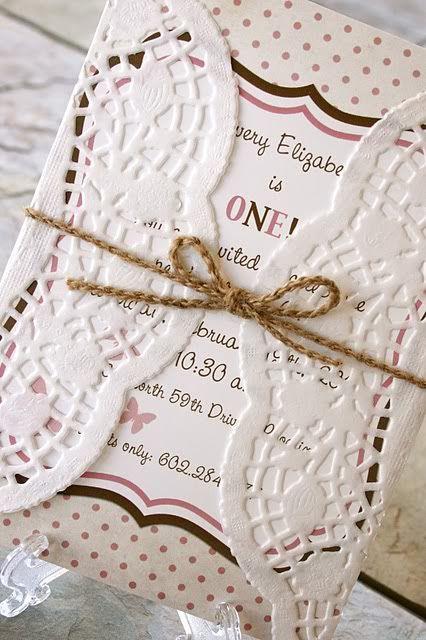 Wrapping the invites in paper doilies.