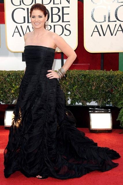 Debra Messing wore a Donna Karan pre-spring/summer 2013 black strapless gown.