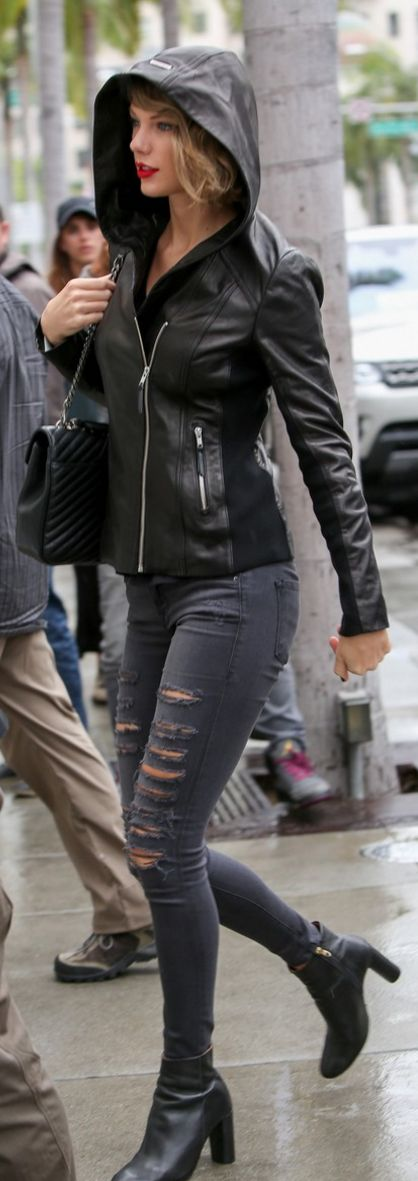 Who made Taylor Swift's black leather jacket, ankle boots, handbag, and gray skinny ripped jeans?