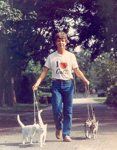 crazy cat man. A true cat lover !