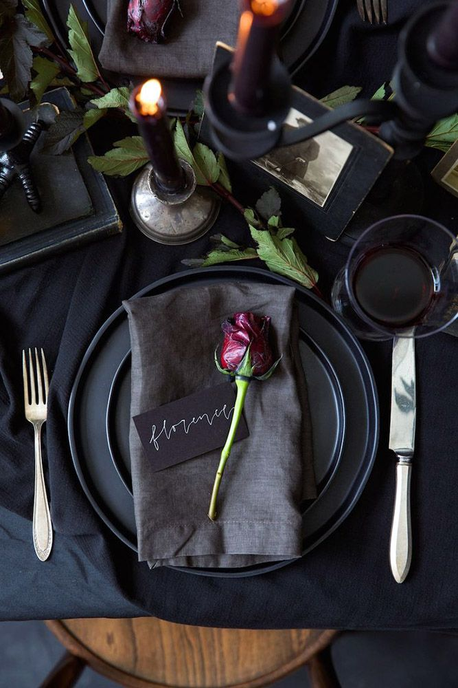 Awesome Halloween Wedding Ideas For Couples Who Love Halloween ❤ halloween wedding ideas on a table a black tablecloth a plate and a napkin are decorated with a dark burgundy rose and candles kate lesueur ❤ See more: http://www.weddingforward.com/halloween-wedding-ideas/ #wedding #bride