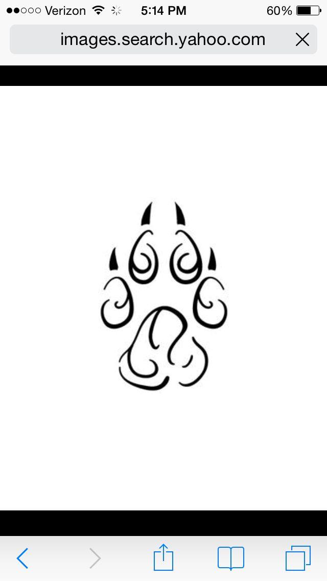 Tribal wolf paw line tattoo