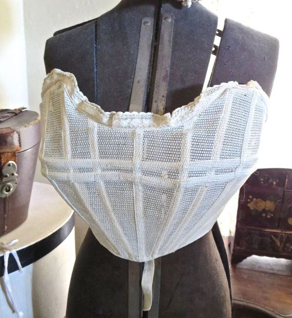 """Bust enhancer"", 1902. ""A design used to 'enhance' the figure of a slimmer chested woman, to adhere to the pigeon breasted fashion. Some of the designs featured ruffles worn under your shirtwaist and jacket, but this lightweight clever design had ""strong cotton net heavily boned vertically"" so that air could flow through. It simply tied in the back making it an adjustable circumference size."""