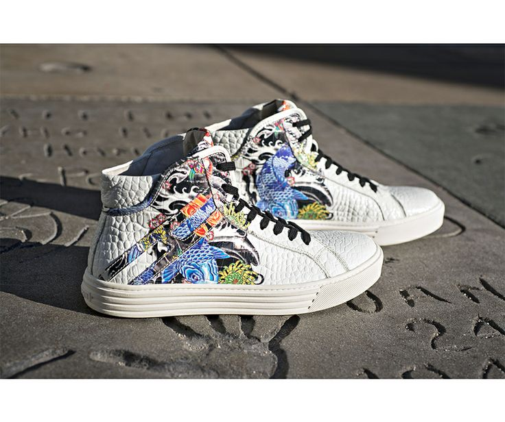 #HOGANREBEL Men's R206 Hi-Top sneaker decorated in  oriental tattoo stamp. Check out this rebel style mix.