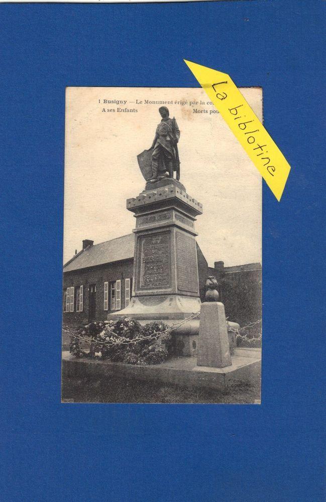 CPA - BUSIGNY (59) - MONUMENT ERIGE PAR LA COMMUNE A SES ENFANTS MORTS .. - 1925