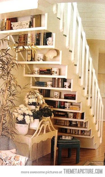 Book staircase! What a great space-saver for a part of the house that has always seemed awkward to me.: