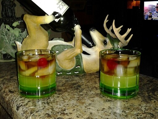 Gator juice for 2 :) This is made with Melon liqueur, Malibu rum, Myers rum and Pineapple juice. Don't forget the cherry! ;)