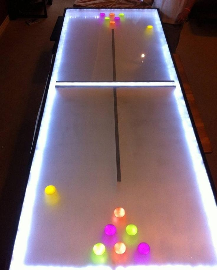 Light Up Beer Pong anyone? This blog's tutorial is pretty advanced, BUT it's so easy to add an LED Ice Cube to each cup for decoration. Glowing cool lights = PARTY TIME