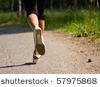 stock photo : Girl running in the park. Active woman running. A confident female runner has the stamina to conquer all.