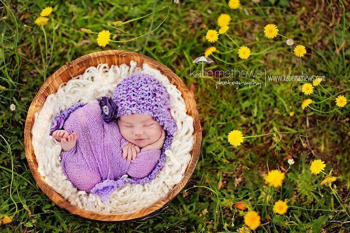 Katie Mathews Photography. newborn girl outside flowers