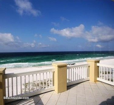Large Gulf-front patio at one of the  homes listed with Destin Beach House Rentals