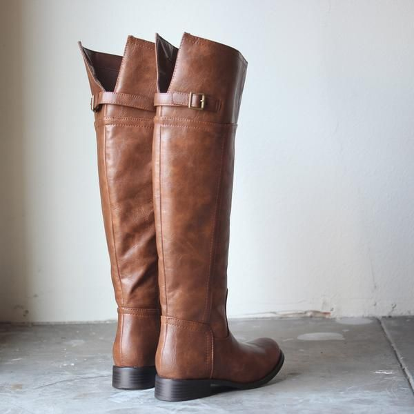 """These amazing riding boots feature a side zipper for a quick easy an easy in and out, and sassy brass side buckle. Calfs are adjustable with tab.  Fits true to size all man made material Heels: 1.5""""Shaft height: 19.5""""Calf diameter: 15.5"""""""