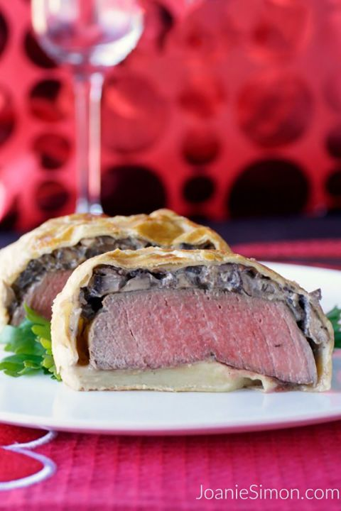 Beef Wellington:  Puff pastry covers filet mignon and a thin layer of mushroom ragout in this elegant meal for two.