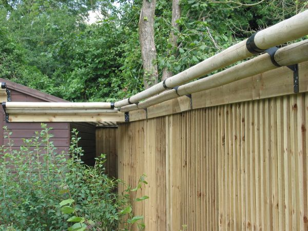 ingenious cat proofing made from rolling wooden poles