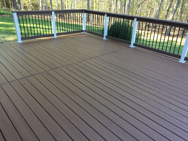 Did the deck today and love the double shade deck paint colors. Behr chocolate on deck with behr white and behr wood chip on railing .