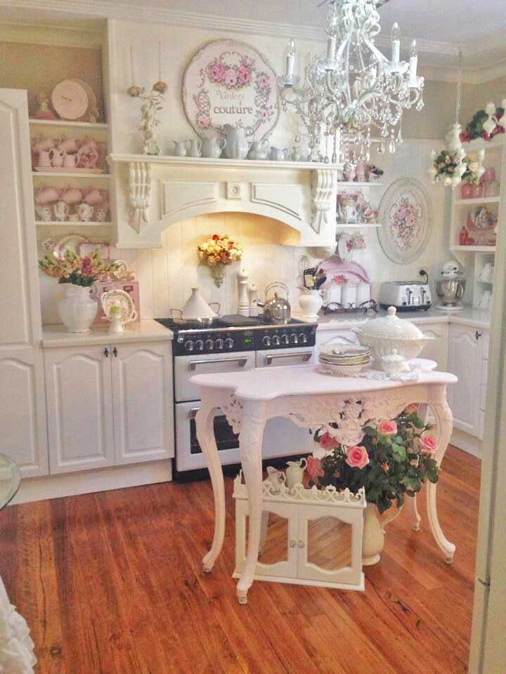 Shabby Chic and so pretty. With carved wooden corbels supporting the mantel shelf, this kitchen is truly 'in the pink'. You can buy similar carved wooden corbels at www.buycarvings.com