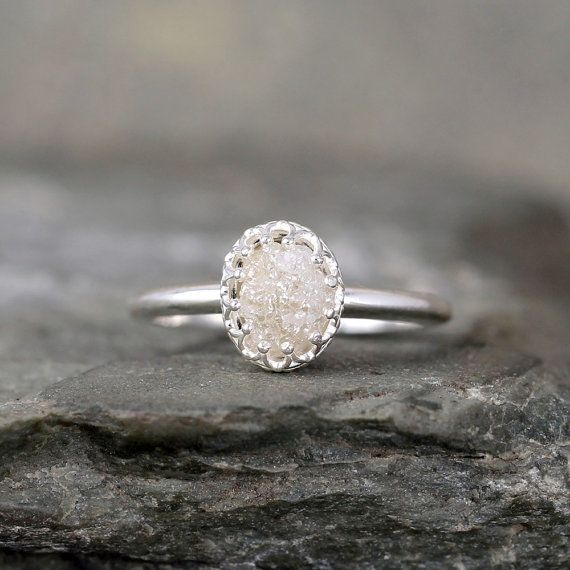 A unique raw, uncut, rough genuine diamond is the highlight on this sterling silver solitaire ring. The natural rough diamond is unique - exactly the