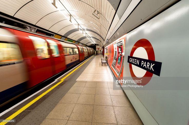 Tube train rushing through Green Park tube station, London, UK.