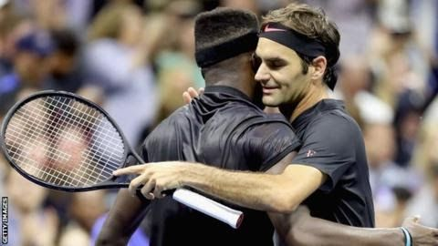 Roger Federer (right) joined Rafael Nadal as one of only nine players to complete their matches on Tuesday  US Open  Venue: Flushing Meadows New York Dates: 28 Aug-10 Sept  BBC coverage: Live radio and text commentary on selected matches every day.  Five-time  champion Roger Federer needed five sets to overcome American teenager  Frances Tiafoe in the first round of the US Open.  The 36-year-old Swiss won 4-6 6-2 6-1 1-6 6-4 in his first ever match under the Arthur Ashe Stadium roof. Third…