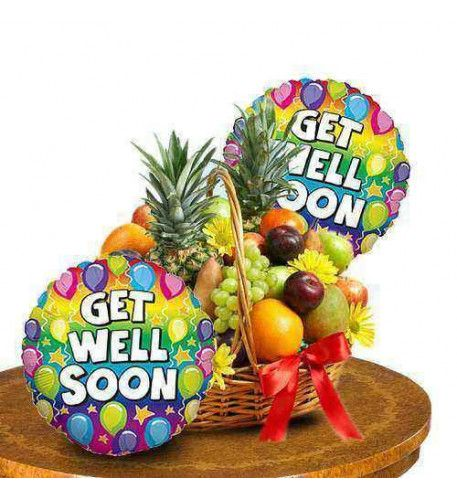 """Organic Treatment Your get well wishes cannot be any fresher than this fruit basket. This classic collection of fresh juicy fruits is simply better than just words. A mouthwatering mixture of apple, pineapple, orange, guava and grapes arrives in woven basket with a little touch of yellow sunflowers. This is one of the most popular treatment for someone along with two colorful mylar """"Get Well"""" themed balloons."""