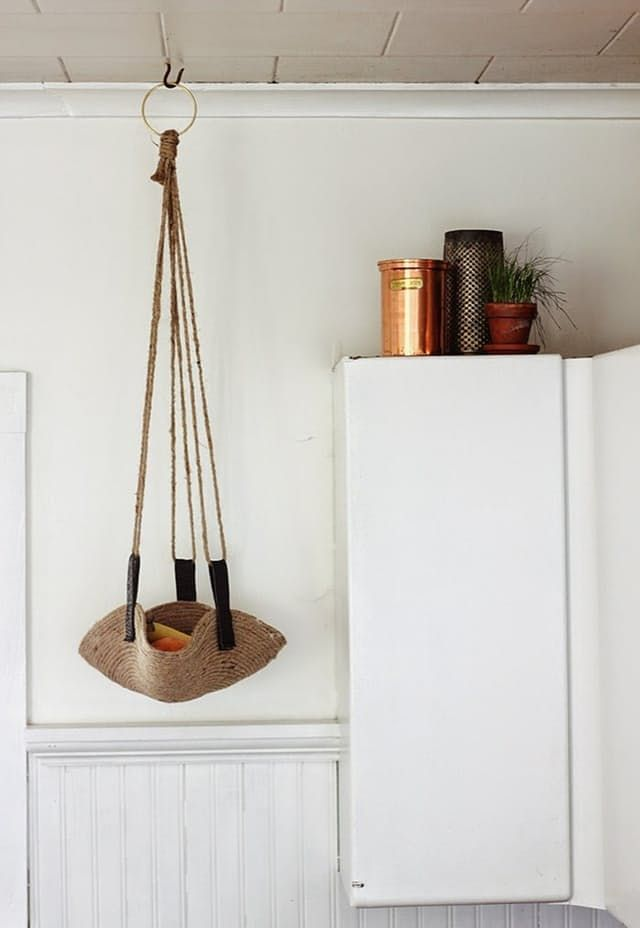 Being space-savvy in small apartments and homes means working in as much storage as possible. The trick is to fill all awkward and/or available spaces with as many low-profile shelves, hanging baskets, and secret compartments as you can muster. Here are 10 DIY projects that keep square footage in mind, but don't sacrifice design.