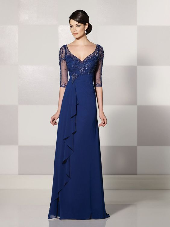 Cameron Blake - Georgette chiffon mock-wrap A-line dress with hand-beaded illusion elbow-length sleeves, beaded illusion modified V-neckline over a sweetheart bodice, sheer beaded keyhole back, empire