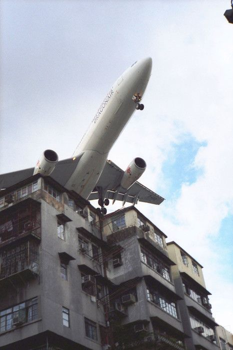 Hong Kong's now-defunct Kai Tak Airport forced jets to fly through high-rise buildings in order to land. Before its closing in 1998, planes would sometimes overrun the landing strip and crash into the adjacent harbor.