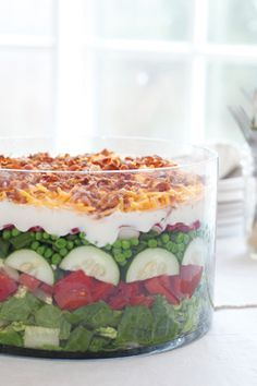 """Paula Deen's ~~~ """"7-Layer Salad""""  ~~~  Awesome salad.    My Mother-In-Law has been making this for years.  We'd all give her heart palpitations when we'd offer to """"toss the salad"""" for her.  She was so afraid we'd 'mess up' her pretty salad....It was always good for a laugh."""