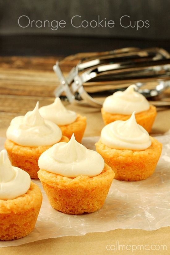 Orange Cookie Cups thick & crispy on the outside, soft on the inside & stuffed with Orange Cream Cheese Frosting, so irresistible, you can't eat just one!!