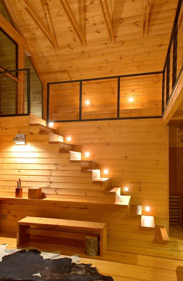 This family vacation house, with a surprising and playful design, has two bedrooms, and these beautiful stairs with lighting.   Tiny Homes