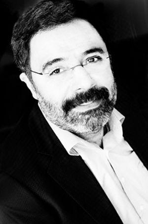 """Ahmet Ümit, (1960-    ), Türk yazar (Turkish novelist).  """"Bir Ses Böler Geceyi (A Voice Divides the Night)"""", """"Sis ve Gece (The Fog and the Night)"""", """"Beyoğlu Rapsodisi (Beyoglu Rhapsody)"""", """"Bab-ı Esrar (The Dervish Gate)"""", """"İstanbul Hatırası (A Memento for Istanbul)""""."""