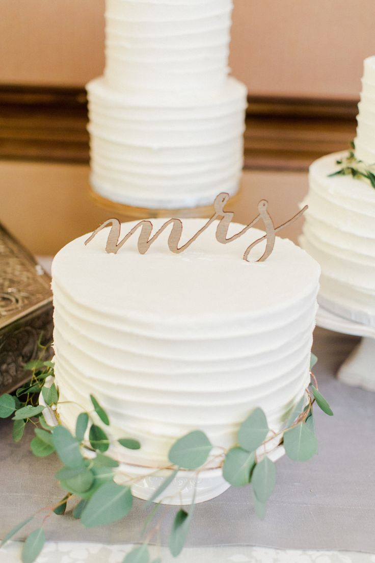 A Dash of Details   Petite wedding cakes get dressed up with eucalyptus and sweet scripted toppers