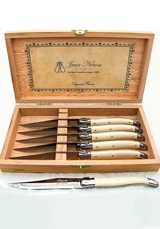 Set of 6 lovely Ivory-colored Steak Knives in a beautiful wooden presentation box. These knives are made in France to centuries old specifications. Add a taste France to your dinner table with a set o
