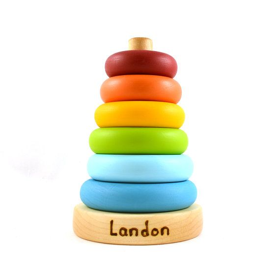 Our personalized wooden ring stackers are a great toy for babies and toddlers. This Waldorf and Montessori inspired toy is designed to encourage the