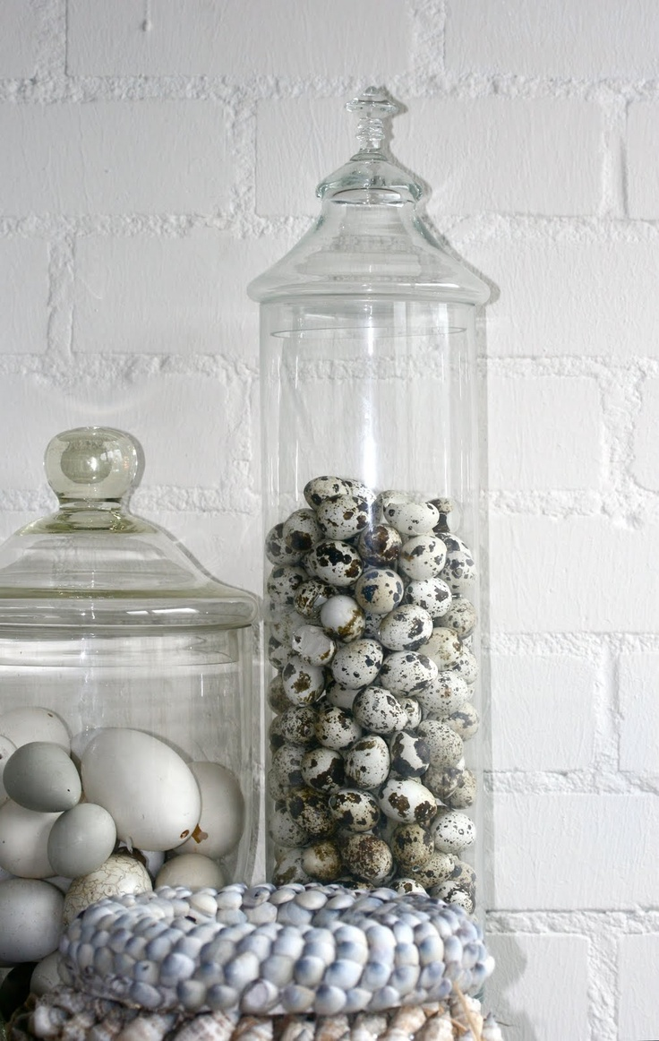 Eggs in glass jars, cute...maybe you could do a mixture of sizes?