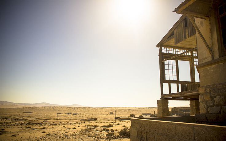 Early morning sun at Kolmanskop casts beautiful light onto the desert sands.