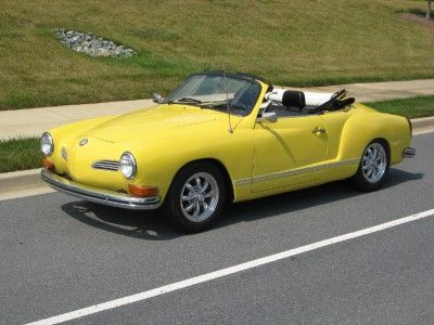 This is exactly what my first car looked like - same model, same car! 1973 VW Karmann Ghia convertible in Yukon Yellow