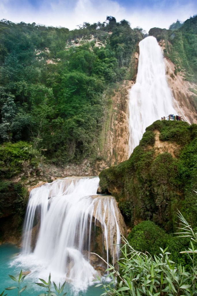 https://flic.kr/p/7tXZNP | El Chiflon (121) | About 30 minutes drive from the colonial city of Comitan Chiapas is El Chiflon, a waterfall that seemingly protrudes from the mountainside and as you drive towards it, it has the shape of angel's wings.  There is an Eco Center at the entrance to the Chiflon Reserve, and a paved walkway that hugs the edge of the river. There are small huts and BBQ areas where you can bring your own food to enjoy a picnic, the center also offers cabins, shops, a…