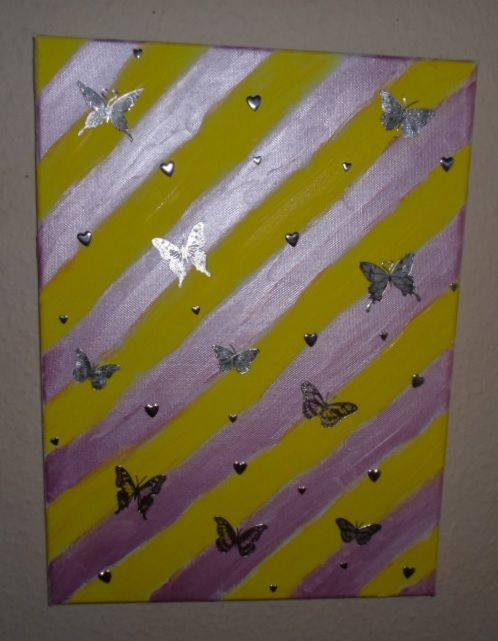 Striped painting with butterflies and hearts.